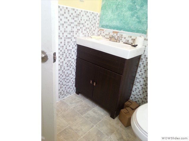 New vanity, top,faucets and mosaic tile