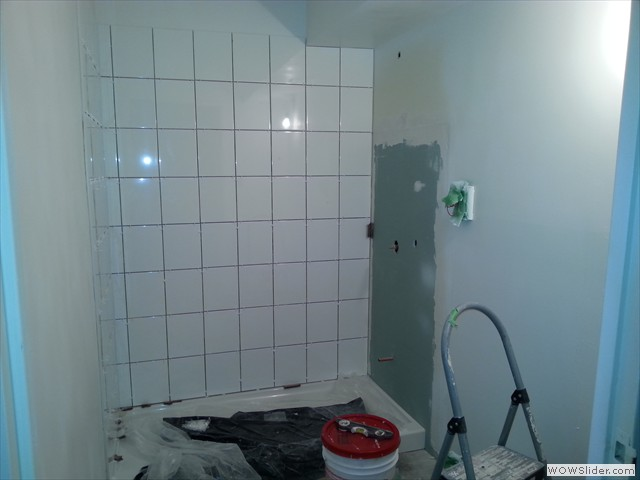 Tub replaced with shower base and new tile